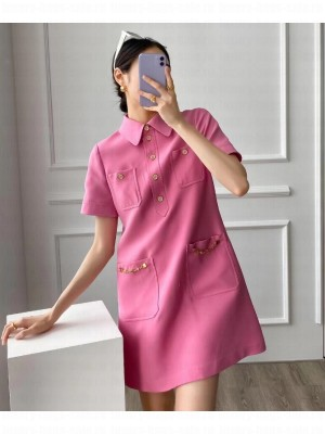 GUCCI                                                                                        Polo dress with chain details